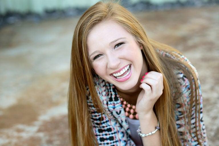 senior portrait of girl laughing in lawrenceville, ga