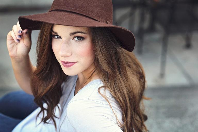 senior photo of girl in hat in decatur square